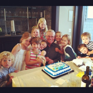 Ten of of twelve of the grandkids. They love their Pop. (They also love cake.)